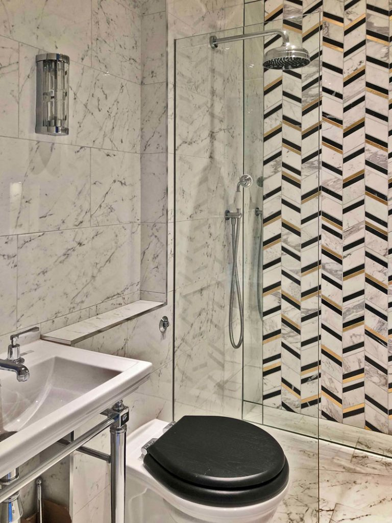 luxury shower design - marble sawtooth design