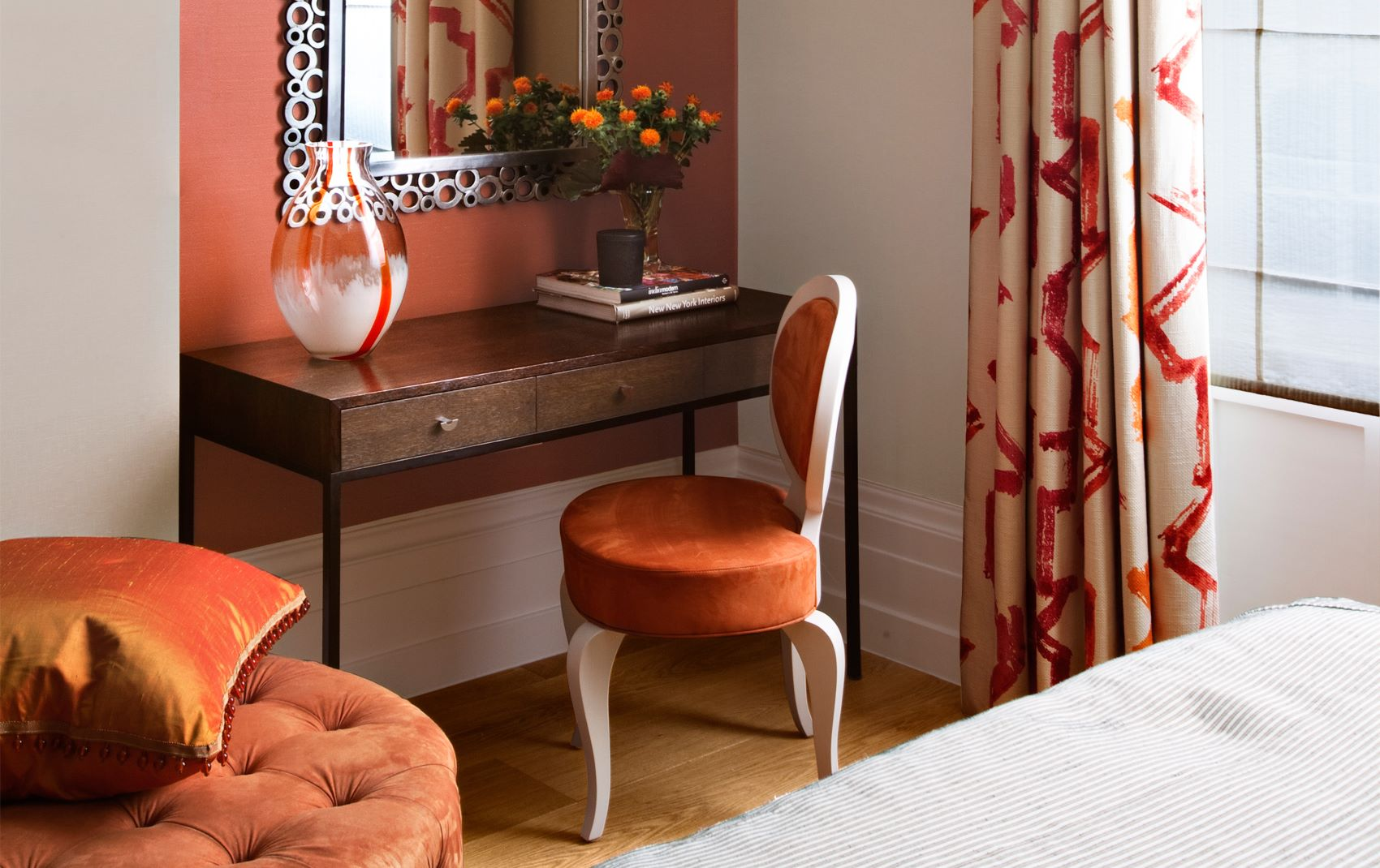 kensington mansion flat - orange chair with decorative desk